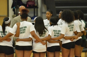 Cass Technical High School Junior Varsity Volleyball Team locking arms before a championship playoff match