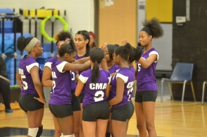 Communication and Media Arts High School Junior Varsity volleyball Team reviewing strategy before a championship match