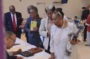 autographing books after worship at the Church of the Open Door in Miami, Florida